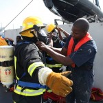 Defence Force Marines fitted in fire suits for the ship's fire drill.