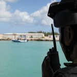 A Commando Squadron Marine making radio contact with a Defence Force Fast Patrol Vessel gathering Intel from a Boarding exercise.
