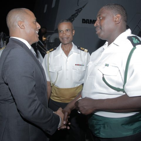 Minister of National Security, the Honourable Marvin Dames having a light moment with Commander Defence Force Commodore Tellis Bethel and President of the Warrant Officers and Senior Rates Mess, Petty Officer Rory Adams