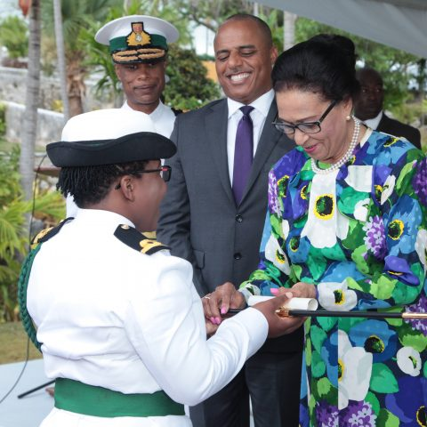Sub Lieutenant Earnestine Cleare receiving her sword and Letter of Commission from  Her Excellency Dame Marguerite Pindling on April 20, 2018.