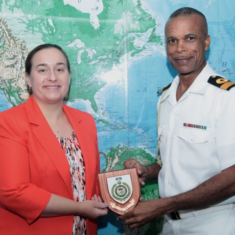Commodore Tellis Bethel presenting a token of appreciation to  Ms. Stephanie Bowers, US Chargé d'Affaires during her courtesy call on April 12, 2018.
