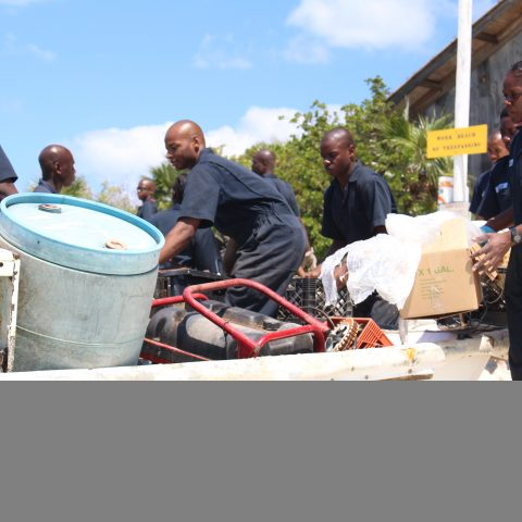 Defence Force Marine Recruits removing an old appliance at the Exuma Cays Land and Sea Park during a recent clean-up effort.