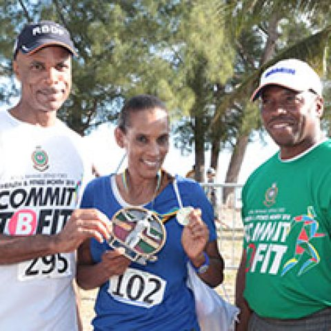 Eve Dorsette Maycock receiving her award as the top female walker at the RBDF Fun Run/Walk and Health expo on April 14, 2018 also shown are: RBDF Commodore Tellis Bethel and Training Officer Lieutenant Origin Deleveaux Jr.