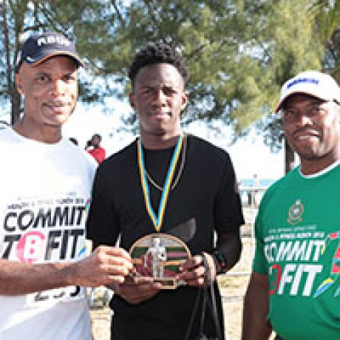 Glenroy Williams receiving his award as the top male runner at the RBDF Fun Run/Walk and Health expo on April 14, 2018 also shown are: RBDF Commodore Tellis Bethel and Training Officer Lieutenant Origin Deleveaux Jr.