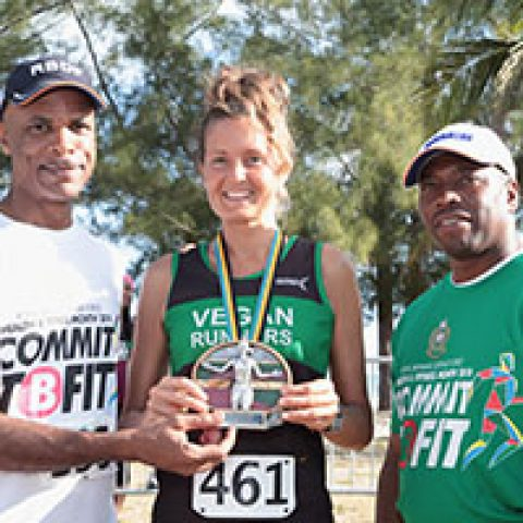Roberta Fontana receiving his award as the top female runner at the RBDF Fun Run/Walk and Health expo on April 14, 2018 also shown are: RBDF Commodore Tellis Bethel and Training Officer Lieutenant Origin Deleveaux Jr.