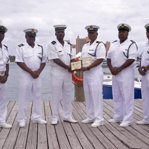 Group shot of all recipients.  (Pictured from left): Petty Officer Kevin Seymour, Chief Petty Officer Fredrick Smith, Chief Petty Officer Pedro Rolle, Petty Officer Wilbert Gilbert (receiving award for Deon Dames Jr. (in his absence), Marine Seaman Philip Clarke, Leading Seaman Mario Ramsey, Marine Seaman Selvin Richards Jr. and Commanding Officer of Harbour Patrol Unit, Senior Lieutenant Andrew Bowe)