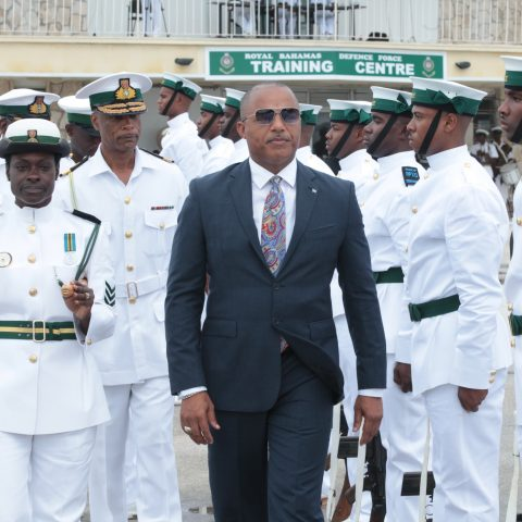 Minister of National Security Hon. Marvin Dames, Commander Defence Force Tellis Bethel with RBDF officers conducting parade inspection.