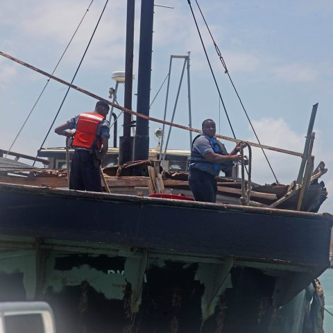 Able Seaman Warren Godet and Marine Seaman Dion Dames working hard to secure the freighter before any further damage is caused.