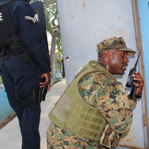 Sub Lieutenant Delroy Dennis communicating with his troops during the final Tradewinds Exercise at the South Beach Pools on June 20, 2018.