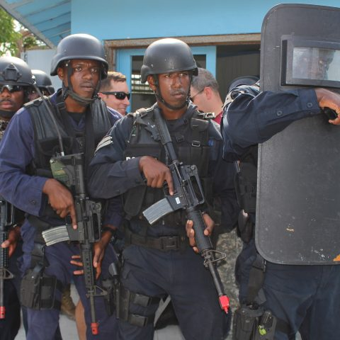 The contingent of  Royal Bahamas Police Force Officers preparing to launch an attack on the enemy during a simulated assault at the final Tradewinds Exercise at the South Beach Pools on June 20, 2018.