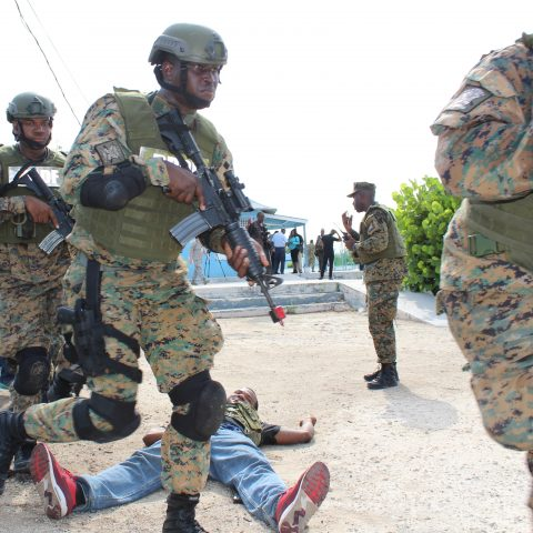 "Royal Bahamas Defence Force Marines taking down the ""bad guys"" during a simulated assault at the final Tradewinds Exercise at the South Beach Pools on June 20, 2018."
