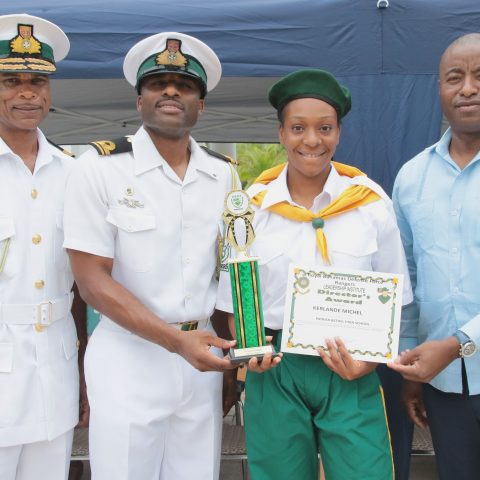 Kerlande Michel of Patrick Bethel High School receiving the Rangers Director Award  during the Passing Out Parade on the island of Abaco. Standing from left: Commodore Tellis Bethel, Rangers Director Lieutenant Delvonne Duncome, Ranger Cadet Kerlande Michel and the Honorable Darren Henfield, Minister of Foreign Affairs and Member of Parliament for North Abaco.