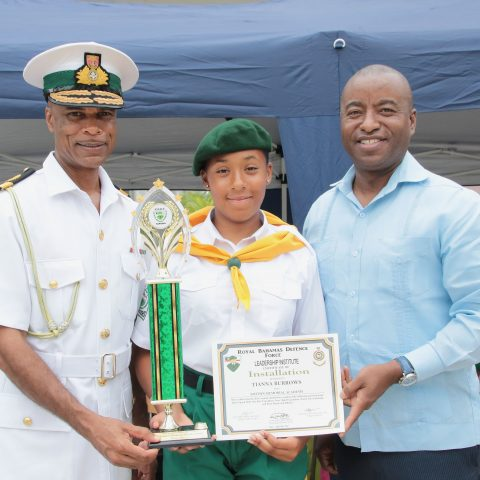 Tiana Burrows of Smith's Memorial Academy receiving the the Minister of National Security Award at the Passing Out Parade on the island of Abaco. Standing from left: Commodore Tellis Bethel, Rngers Cadet Tiana Burrows and he Honorable Darren Henfield, Minister of Foreign Affairs and Member of Parliament for North Abaco.