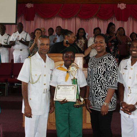 Sierra Farrington from North Eleuthera High School receiving the overall Minister of National Security Award. Standing from left:  Commander Defence Force, Commodore Tellis Bethel; Sierra Farrington; Ms. Gaye Bowe, North Eleuthera Administrator in Training; and Lieutenant Delvonne Duncombe, Rangers Director.