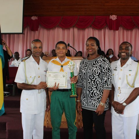Colby Mullin of Samuel Guy Pinder All-Age School receiving the Commander Defence Force Award. Standing from left:  Commander Defence Force, Commodore Tellis Bethel; Colby Mullin; Ms. Gaye Bowe, North Eleuthera Administrator in Training; and Lieutenant Delvonne Duncombe, Rangers Director.