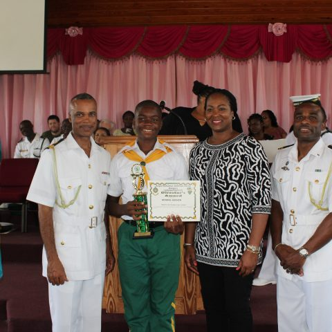 Kendal Gibson of North Eleuthera High School receiving the Rangers Director Award. Standing from left:  Commander Defence Force, Commodore Tellis Bethel; Kendal Gibson; Ms. Gaye Bowe, North Eleuthera Administrator in Training; and Lieutenant Delvonne Duncombe, Rangers Director.