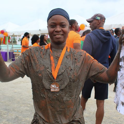 Leading Woman Marine Lashanna Williams showing her enthusiasm after completing the Bahama Health Mud Run 2018.
