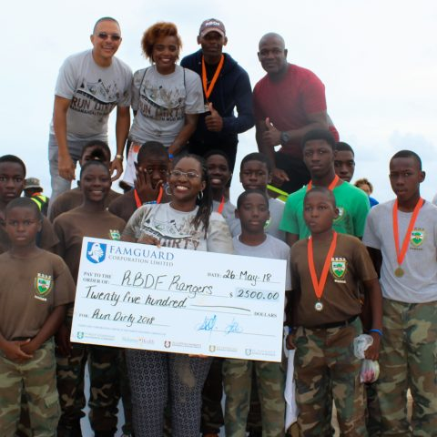 RBDF Rangers being presented with a cheque from the Bahamas Health Foundation.