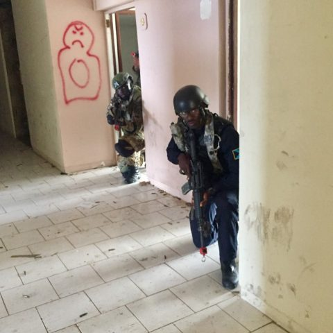A Royal Bahamas Police Force Officer and a Royal Bahamas Defence Focrce Marine providing rear security during a simulated raid at Tradewinds 2018 Exercise in St. Kitts.