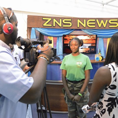 A young Ranger Cadet showcasing her talent during a tour at the Bahamas Broadcasting Corporation Northern Service.