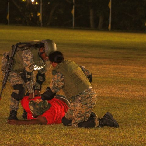 Defence Force Marines taking down a person of interest during a simulated terrorist threat exercise during the 45th Independence celebrations on Clifford Park on July 9, 2018.