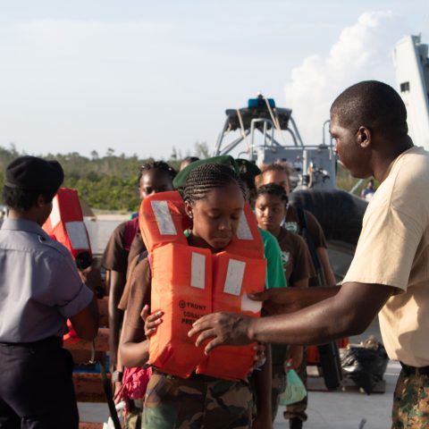 Able Seaman Durchin Sands and Woman Marine Eddicia Carey conducting a safety check of the Rangers life vest prior to boarding HMBS Lawrence Major. The RBDF Rangers are attending a 3-week Summer Camp in Freeport, Grand Bahama.