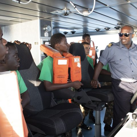 Lieutenant Allan Dixon giving the Rangers a tour and explaining the navigational equipment in the bridge of HMBS Lawrence Major. The RBDF Rangers were on their way to attend a 3-week Summer Camp in Freeport, Grand Bahama