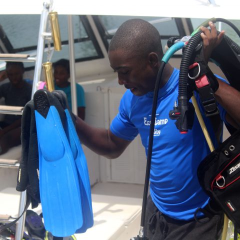 Jerai Brennen, Ranger Officer at Forest Heights Academy, Abaco, gathering his equipment for a dive exercise at the RBDF Rangers Summer Camp in Grand Bahama.