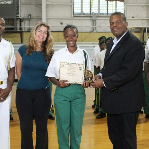 Rangers Cadet Raven Davis receiving a certificate for her outstanding work in the Photojournalism Course. Photo shows from left: Lieutenant Delvonne Duncombe, Ranger Director; Ms. Sherry Wood, Open Water Diver and volunteer; Cadet Raven Davis; Mr. Eugene Poitier, Acting Permanent Secretary in the Ministry of National Security; and Commander Chapell Whyms, Executive Officer of the Defence Force's Northern Command.