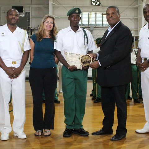 Cadet Kyle Strachan receiving his certificate for Most Outstanding Cadet in the RBDF Familiarization Program. Photo shows from left: Lieutenant Delvonne Duncombe, Ranger Director; Ms. Sherry Wood, Open Water Diver and volunteer; Cadet Kyle Strachan; Mr. Eugene Poitier, Acting Permanent Secretary in the Ministry of National Security; and Commander Chapell Whyms, Executive Officer of the Defence Force's Northern Command.