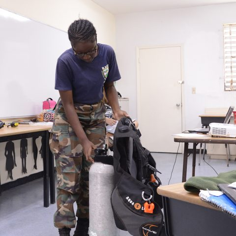 RBDF Ranger Carissa Francois, acclimatizing herself with the dive equipment at the RBDF Rangers Summer Camp in Grand Bahama.