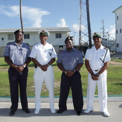 Chief Petty Officer Daniel Miller at HMBS Coral Harbour on August 27, 2018 on his retirement from the Royal Bahamas Defence Force.  From left: Senior Lieutenant Gordon Roberts, Acting Deputy Base Engineering Officer; Commander Michael Sweeting, the Base Executive Officer; Chief Petty Officer Miller; and Force Chief Petty Officer Dwight Baker, Engineering Administrator.