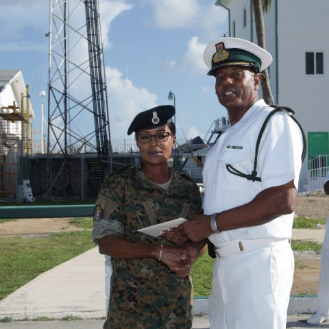 Petty Officer Marianne Fowler receiving a donation from Commander Michael Sweeting, Base Executive Officer on August 27 at HMBS Coral Harbour.