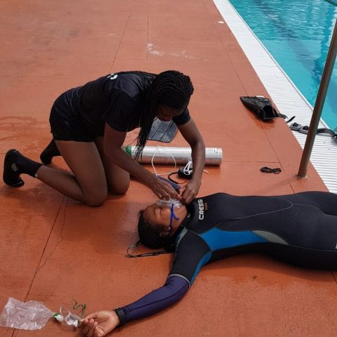 Defence Force PADI Divemasters going through a training routine during the Divemaster Course