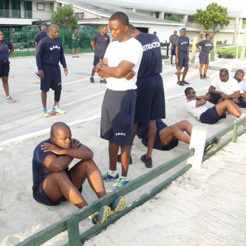 RBDF Personnel participating in the sit-up exercise during the annual Base Fitness Test at the Defence Force Base.