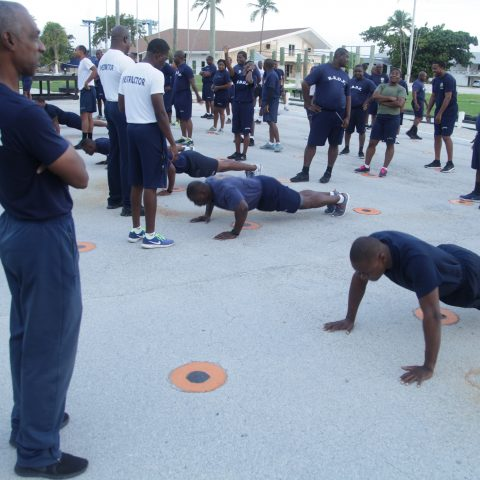 RBDF Personnel participating in the push-up exercise during the annual Base Fitness Test at the Defence Force Base.