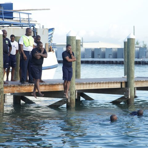 RBDF Personnel jumping into the water to commence the 300 meter swim exercise during the annual Base Fitness Test at the Defence Force Base