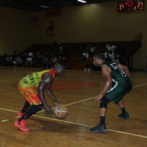 Marine Mechanic Raynold Culmer defending a player from the Cabinet Aces in playoff action of The Bahamas Government Departmental Basketball Association on  Spetember 28, 2018. The Aces won the best of 3 series against the RBDF Mariners in 2 straight games.
