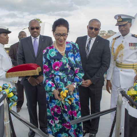 Governor General Her Excellency The Most Honourable Dame Marguerite Pindling performing the traditional cutting of the ribbon during the official Commissioning ceremony for the Royal Bahamas Defence Force patrol craft, HMBS MADEIRA on November 28, 2018. Also shown are: Prime Minister The Most Honorable Dr. Hubert Minnis; Minister of National Security, the Honourable Marvin Dames; Commodore Tellis Bethel, Commander Defence Force and Petty Officer Marguerite Taylor.