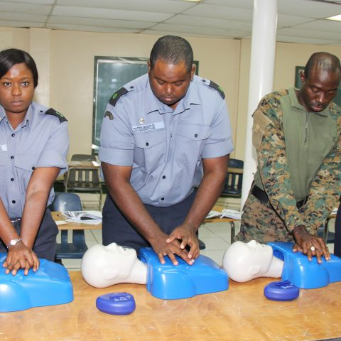 Course Participants in a simulation exercise during the American Heart Association First Aid and CPR Training at the Coral Harbour Base. From left: Leading Woman Marine Lashonna Williams, Able Seaman Theo Cochinamogulos and Aulbourn Knowles and Able Woman Marine Keisha Cooper.