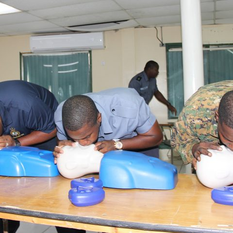 Course Participants performing CPR in a simulation exercise during the American Heart Association First Aid and CPR Training at the Coral Harbour Base.