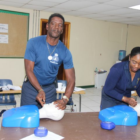 Representatives from The Bahamas Customs Department participating in a simulation exercise during the American Heart Association First Aid and CPR Training at the Coral Harbour Base. From left: Grade 2 Customs Officers Kenneth Major and Robyn Stuart.