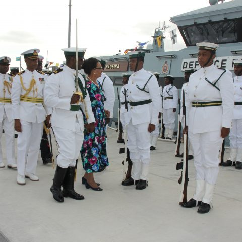 Guard Commander Sub Lieutenant Delroy Dennis escorting the Governor General Her Excellency The Most Honourable Dame Marguerite Pindling during the inspection of the Royal Guard during the official Commissioning ceremony for the Royal Bahamas Defence Force patrol craft, HMBS MADEIRA on November 28, 2018. Also shown are: Commodore Tellis Bethel, Commander Defence Force and Lieutenant Delvonne Duncombe, Aide-de-Camp, Commander Defence Force.
