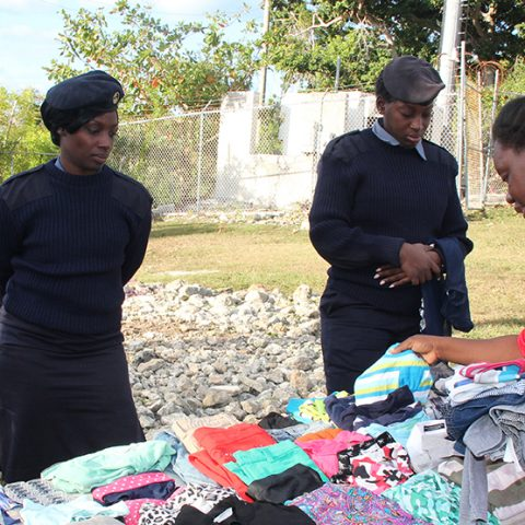 A Gambier resident looking throught the clothing items on display during a community outreach by members of the Defence Force's Supply Department on November 29, 2018.