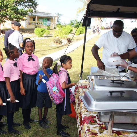 Students of the Gambier Primary School receiving breakfast from members of the Defence Force's Supply Department on November 29, 2018.