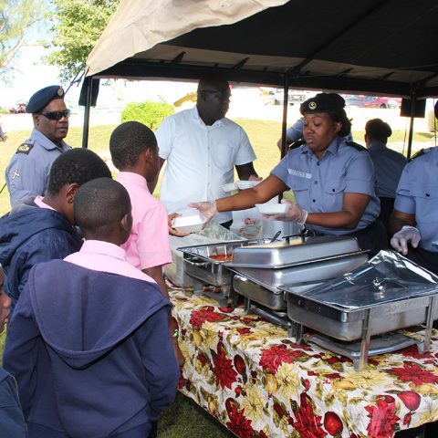 Members of the Supply Department giving out breakfast to students of the Gambier Primary School during a community outreach by members of the Defence Force's Supply Department on November 29, 2018.