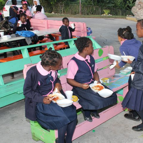 Students of the Gambier Primary School enjoying their hot breakfast during the community outreach by members of the Defence Force's Supply Department on November 29, 2018.