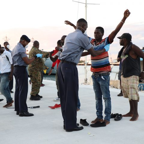 Defence Force Marines Searching Illegal Migrants As a Part Of Operational Procedures