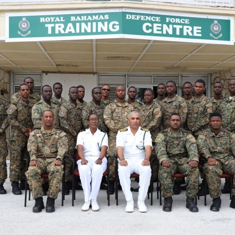 Marines and instructors from the Royal Bahamas Defence Force's (RBDF) Military Police and Force Protection (MPFP) Department during the graduation ceremony of the Close Range Combative Systems (CRCS) training course at the Coral Harbour Base. Also shown are Captain Adrian Chriswell, Captain Coral Harbour (Acting) and Lieutenant Commander Natasha Miller, Exeutive Officer MPFP.