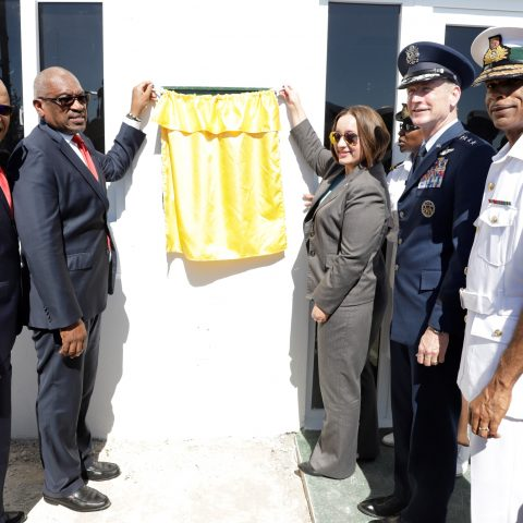 Prime Minister The Most Honorable Hubert Minnis preparing to unveil a plaque to commemorate the official handing over of a $2.1 million Long Range Coastal Radar Bahamas by the government of the United States of America through the US embassy in The Bahamas at Matthew Town, Inagua.  Shown from left: The Honourable Marvin Dames; Prime Minister Hubert Minnis; Chargé d'Affairs, Ms. Stephanie Bowers, at the United States Embassy in Nassau; General Terrance O'Shaughnessy, Commander of the United States North American Aerospace Defence Command; and the Commander Defence Force, Commodore Tellis Bethel.